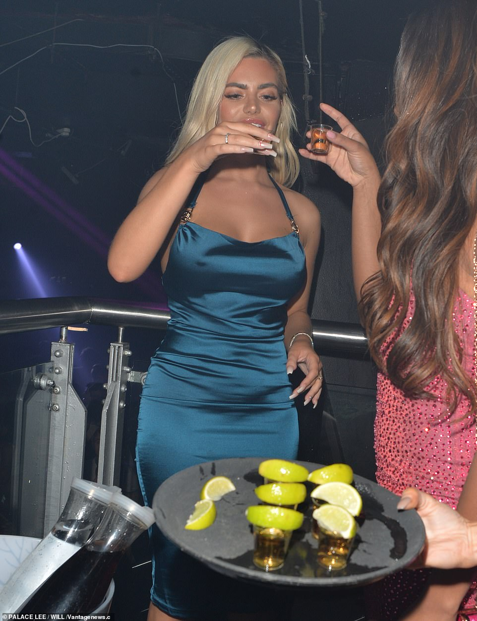Cheers to that: Megan and Samira downed shots of tequila in their VIP area