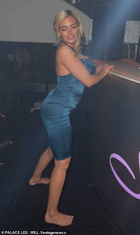 Barefoot beauty: Megan held onto the edge of the DJ booth as she worked her best moves