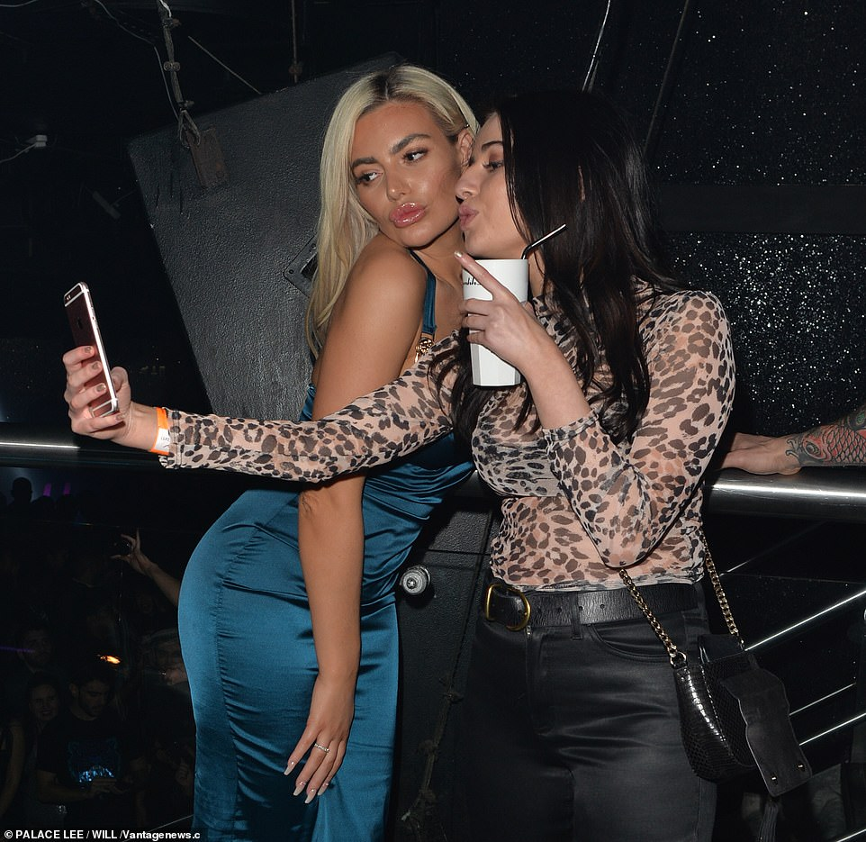 Pout: Megan showed that she knows how to strike a pose as she took pictures with fans