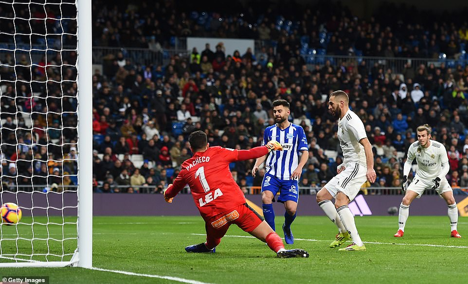 The forward gives Alaves keeper and Real Madrid academy graduate Fernando Pacheco no chance with a clinical finish