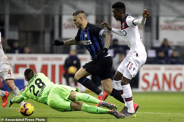 Bologna goalkeeper Lukasz Skorupski saves on Inter Milan's Mauro Icardi as Bologna's Ibrahim M'Baye, right, looks on, during the Serie A soccer match between Inter Milan and Bologna, at the San Siro stadium in Milan, Italy, Sunday, Feb. 3, 2019. (AP Photo/Luca Bruno)