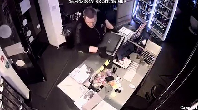 CCTV footage shows a man breaking in through the front doors of the central London salon before ransacking the till for money and swiping valuable goods