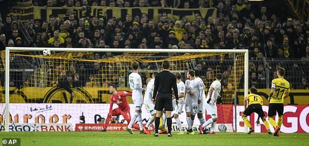Dortmund captain Marco Reus shoots into the top corner to pull level against Werder Bremen