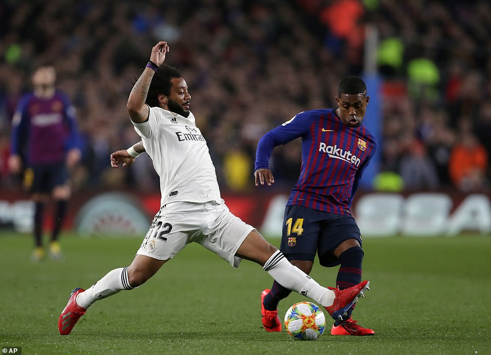 Real Madrid left back makes it across to make a challenge and win the ball from Malcom as he tried to surge forward
