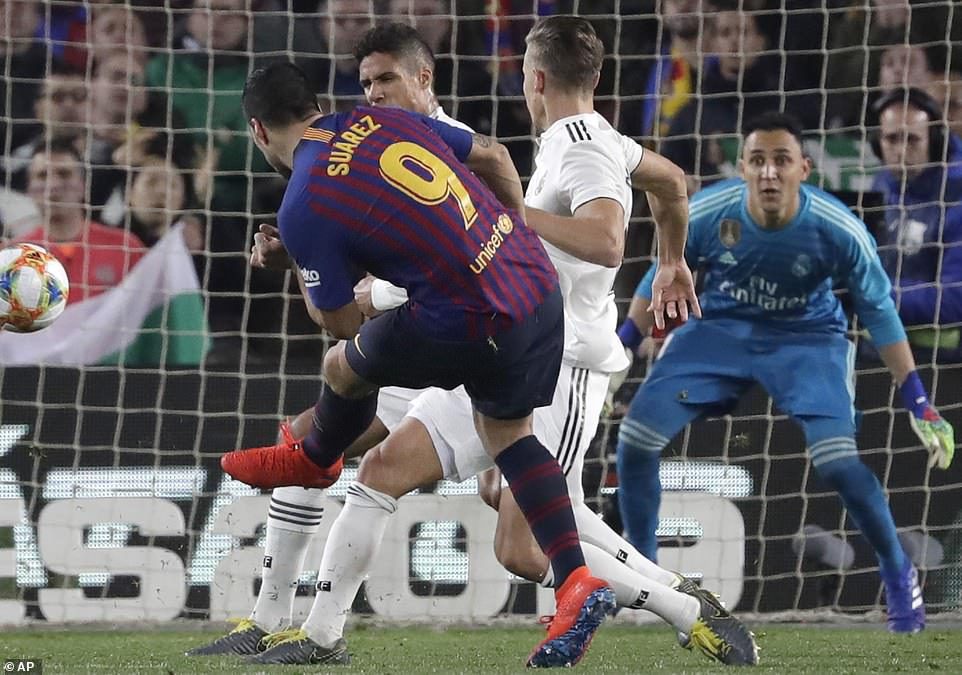 Suarez tries a left-footed curling effort but can't find a way past Navas, who finished the first half without being beaten