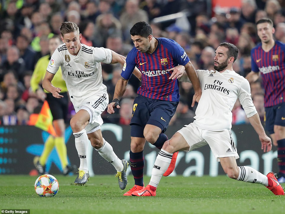 Suarez runs past right back Dani Carvajal (right) as the Barcelona forward makes his way towards the visitors' penalty area
