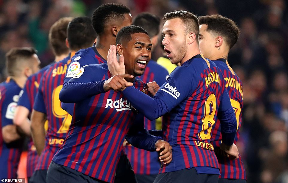 Malcom was mobbed by his team-mates after what had been nearly an hour of frustration in front of the Barcelona supporters