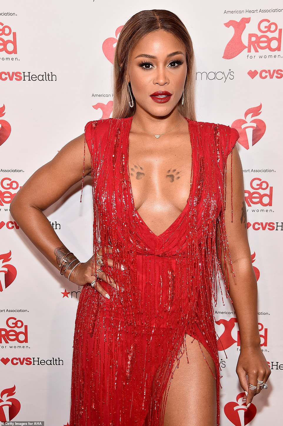 Red-dy for it: Rapper Eve also left little to the imagination in a heavily tasseled dress with a deep plunging neckline