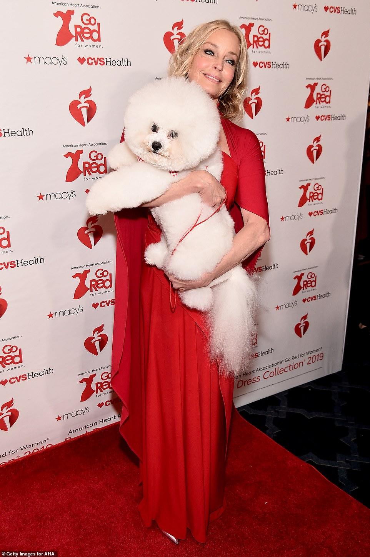 Puppy love! Bo Derek poses with her beloved pooch Flynn