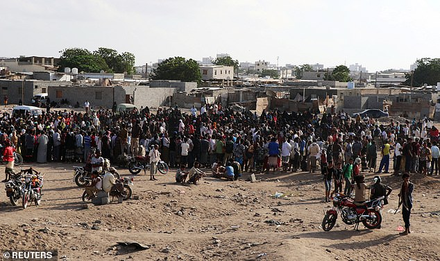 Public execution: Hundreds had gathered at the site of the execution in the Yemeni port city to watch the two men be shot dead