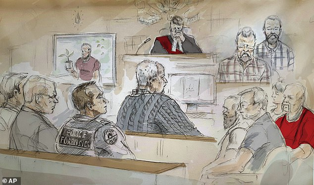McArthur pleaded guilty to eight counts of murder in early 2019. He is pictured center in a court sketch from a hearing where he was sentenced to life in prison