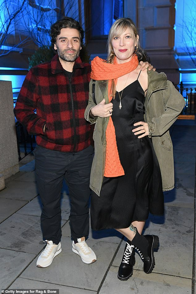 Red-dy or not: Also in plaid was Peters' X-Men: Apocalypse co-star Oscar Isaac