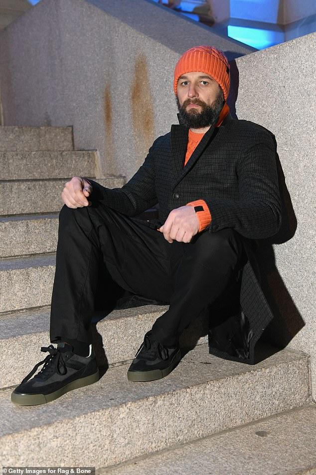 Orange you glad you came? Matthew Rhys added orange flair to his otherwise dark ensemble