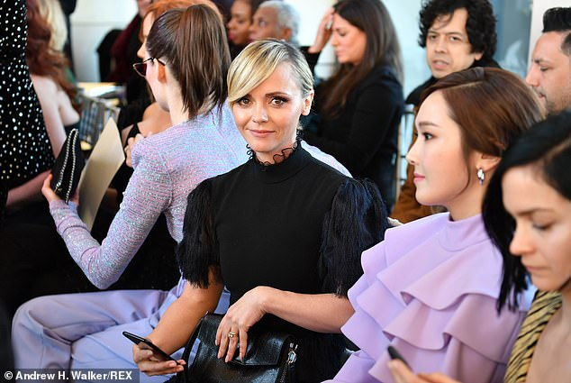 Pride of place: Christina was seated next to Coco in the front row of the fashion show audience, and was glimpsed with her phone out during the bash