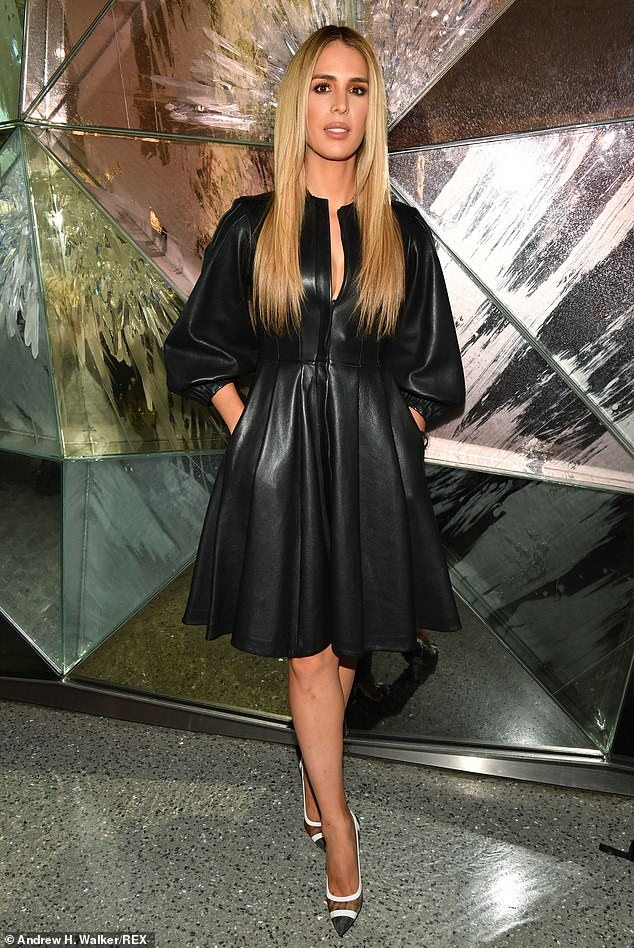 Posing up a storm: Carmen Carrera of RuPaul's Drag Race fame slid herself into a sleek black leather dress with a plunging neckline and a hem at the knee