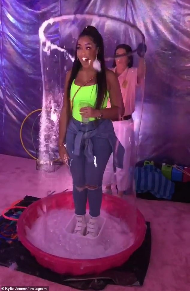Bubble buddy: Kylie recorded BFF Jordyn getting enveloped by a huge human-sized bubble