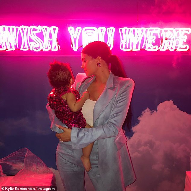 Pulling out all the stops: Kylie Jenner threw her daughter Stormi an ultra lavish party to celebrate her birthday Saturday. Above Stormi is seen with dad Travis Scott