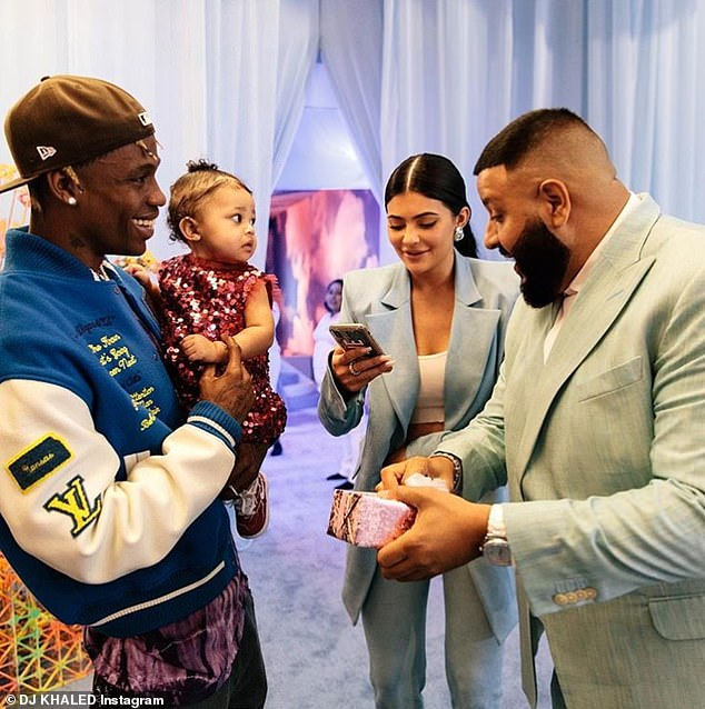 There for them: The I'm The One rapper shared a photo of himself with the Webster family, which he captioned: 'My brother @travisscott and his queen @kyliejenner invited me to Stormi BDAY PARTY.