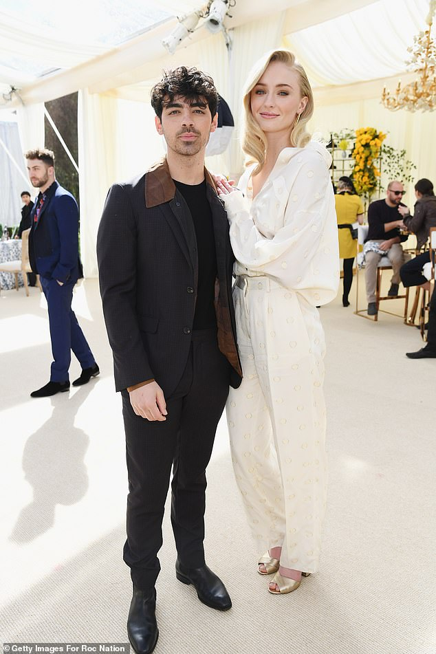 Betrothed:Pop singer Joe Jonas went for the suit-and-tee look as he swung by the fete with his fiancee, Game Of Thrones star Sophie Turner