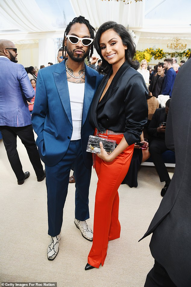 What a date:Miguel's Oxford suit gleamed under the sunlight as he stood for a photograph with his wife Nazanin Mandi, whom he married last year