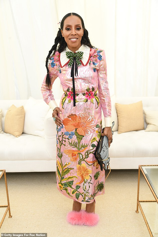 Showstopper: June had decked herself out in an eye-popping floral dress with a pink-trimmed white collar, accented the look with a polka-dot bow-tie and fuzzy slippers