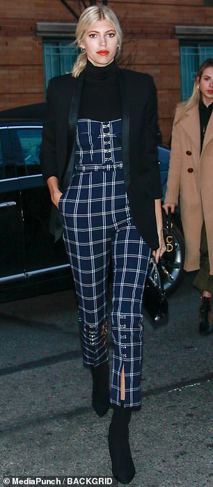 She gets it: Victoria's Secret stunner, Devon Windsor, mixed timeless fashion with a tad bit of trend in her plaid pantsuit, complete with a buttoned bottom