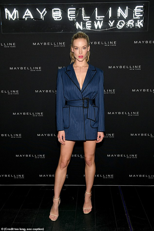 When you got it:Hannah Ferguson wrapped herself in a pajamas-chic blue and black striped robe dress that was hemmed at mid-thigh to show off her vertiginous legs