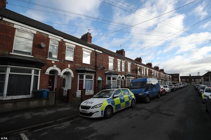 A police car in front of a property on Raglan Street in Hull. The house of Pawel Relowicz is located in this street