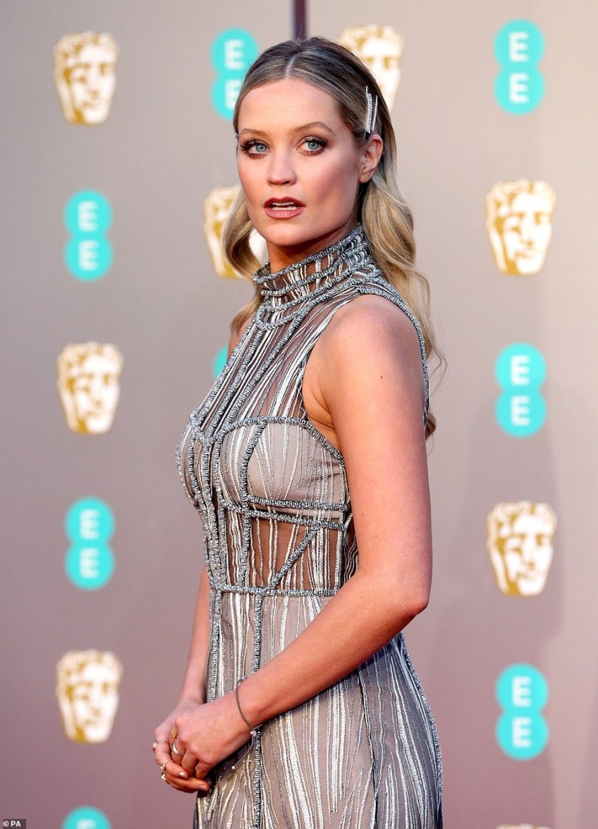 Stunning: Laura Whitmore wore a slinky, shimmering number that cascaded down her lithe frame