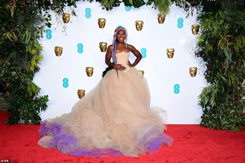 Slaying: Another EE Rising star nominee,Cynthia Erivo was having the time of her life in an opulent cream coloured gown with purple detailing