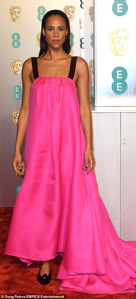 Pink to make the boys wink: Fresh Meat actress Zawe Ashton stood out in an oversized hot pink gown with black straps