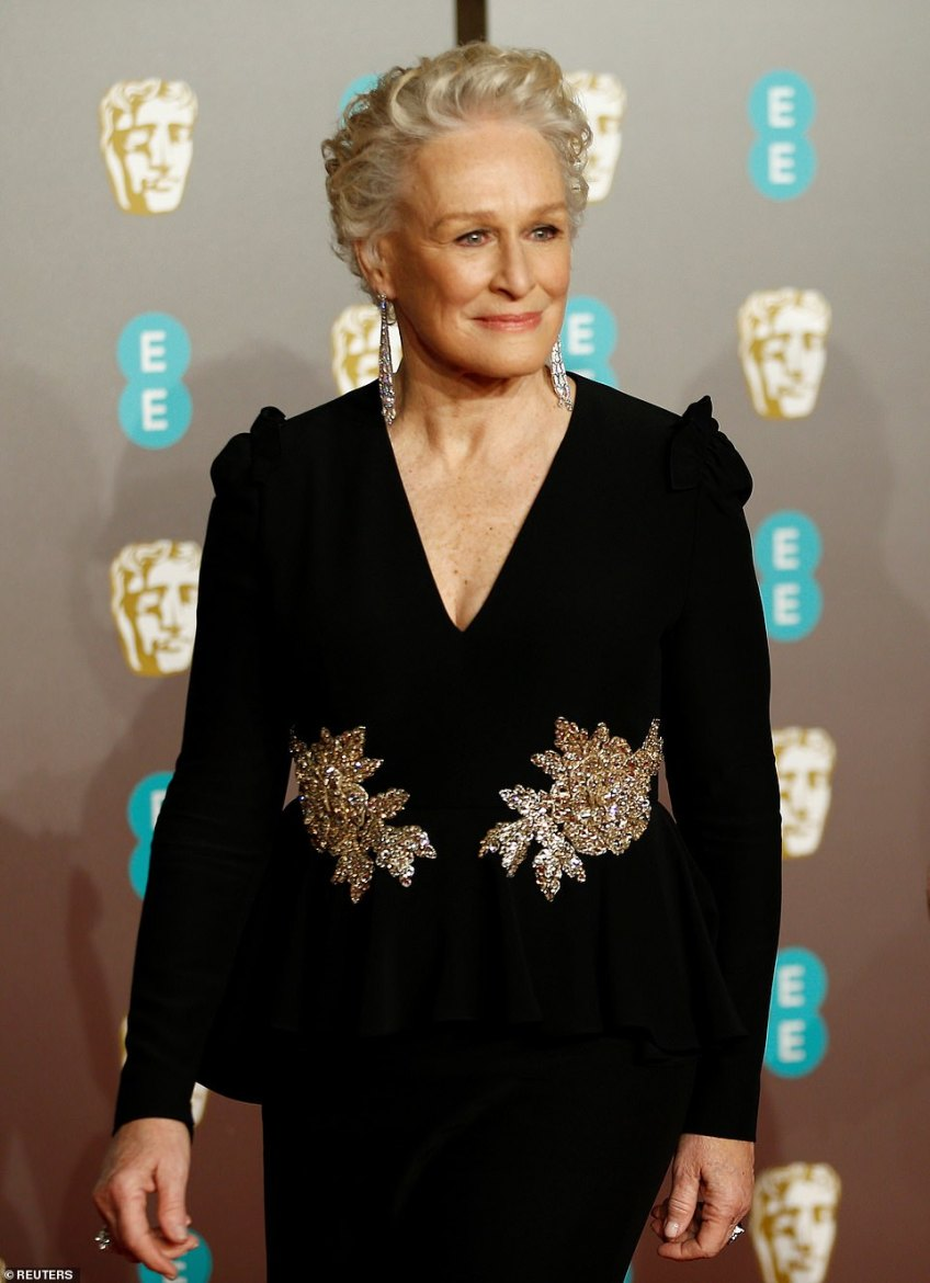 Age-defying: Competing in the Best Actress in a Leading Role for The Wife, Glenn dazzled in a form fitting black dress which featured symmetrical gold dazzling embellishments on both sides