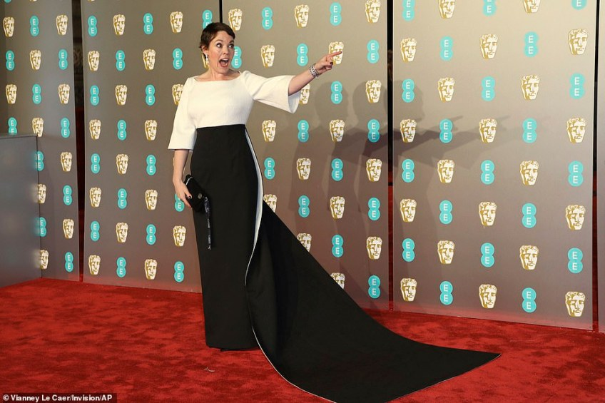 Animated: The British actress, 45, who is taking award season by storm, looked like she was having the time of her life as she posed away on the red carpet