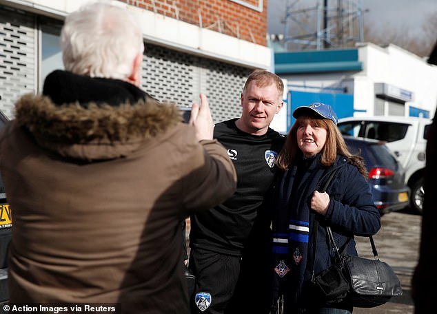 Scholes met fans and posed for pictures outside Boundary Park ahead of his press conference  Paul Scholes reveals why he is worried about Jose Mourinho as he begins his managerial career 9671944 6691505 image a 20 1549892589270