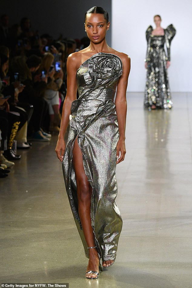 Easy on the eyes: Jasmine also wore this beautiful gunmetal grey gown with a slit up the front