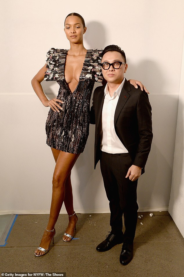 The man of the hour: Lais Ribeiro (L) and designer Nguyen Cong Tri back stage
