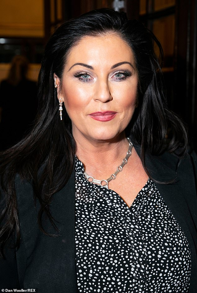 Glamorous: The EastEnders actress sported a heavy make-up application, complete with dramatic smokey eyes and a red lip