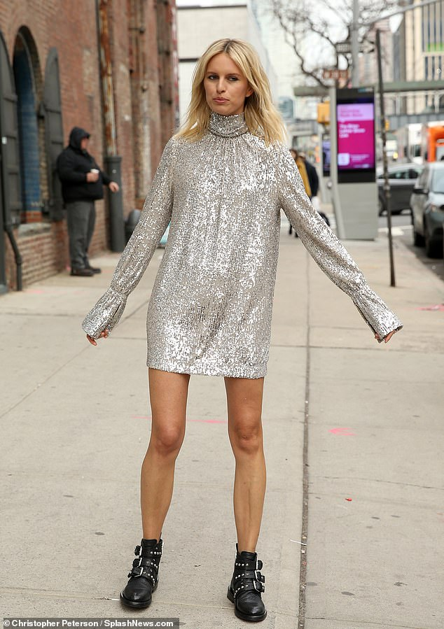 Sensible flats: The Czech-born blonde paired her sparkly frock with a clunky pair of black buckled boots