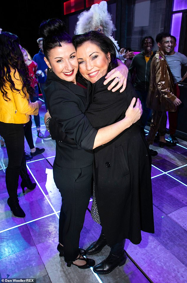 High spirits: Jessie beamed with delight as she shared a cosy hug with screen star Hayley, who plays Miss Hedge in the production