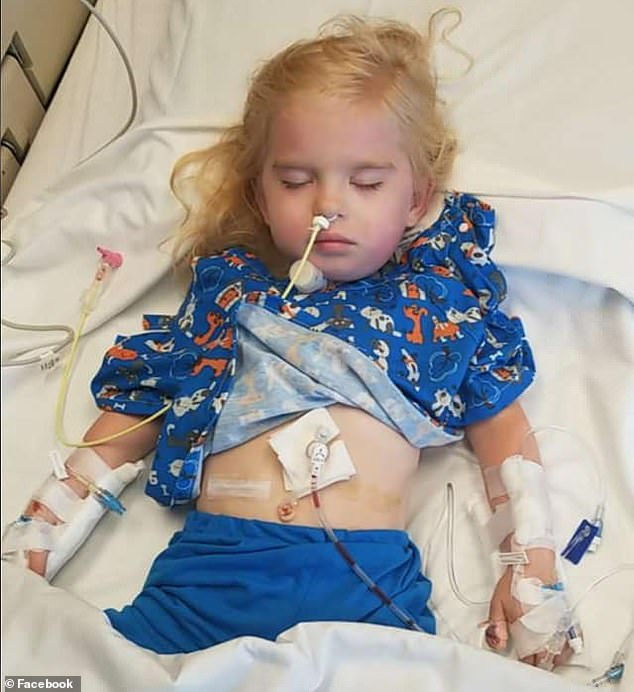 Right before Zoey was delivered, doctors inserted a trach tube so she could breathe. However, she was unable to make any noises. Pictured: Zoey in the hospital