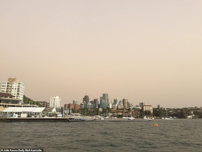The heatwave is continuing on the east coast of Queensland with the mercury hitting 36C in Brisbane. Pictured: Dust over Sydney on Wednesday