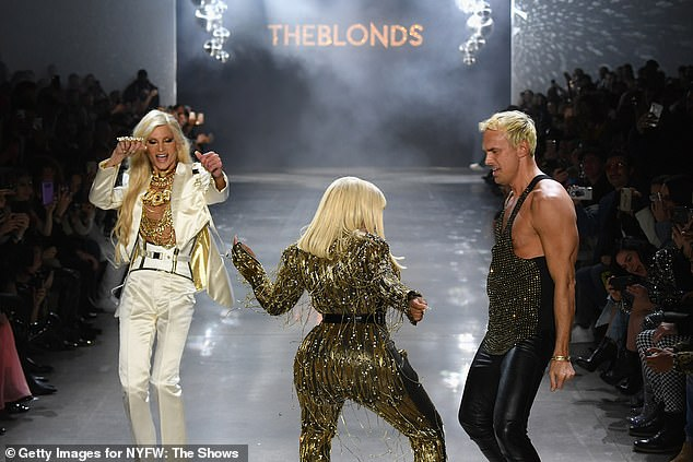 Work it: Lil' looked in her element as she put on an energetic display for the stylish attendees - with Phillipe Blond and David Blond