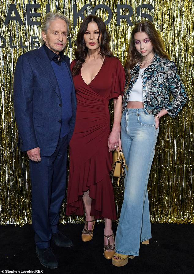 Family affair: Catherine Zeta-Joneslooked was accompanied by husband Michael Douglas and 15-year-old daughter Carys at the Michael Kors Collection show on Wednesday