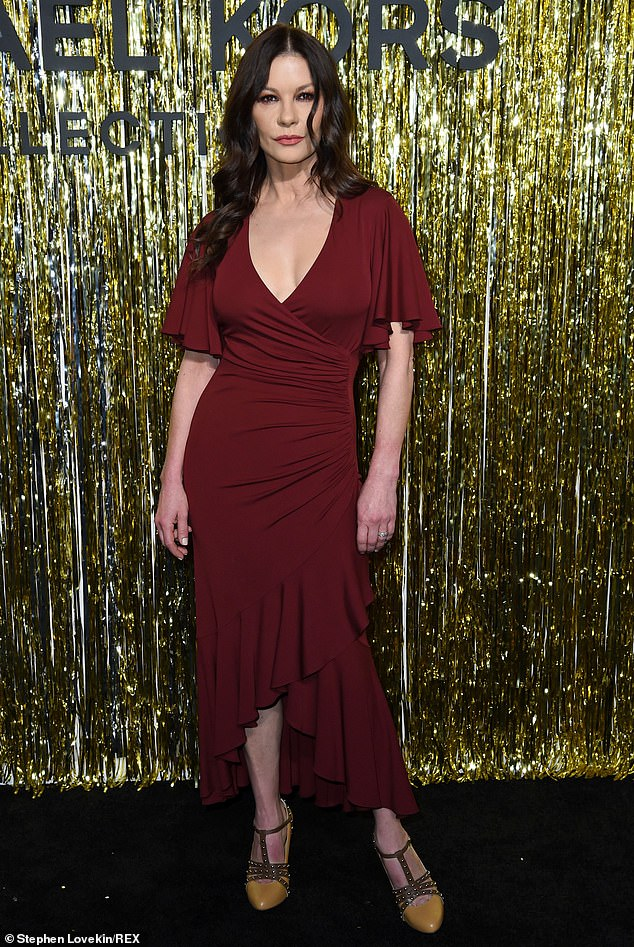 Still stunning: The 49-year-old Entrapment actress looked ravishing in a low-cut red number at the star-studded event in the Big Apple