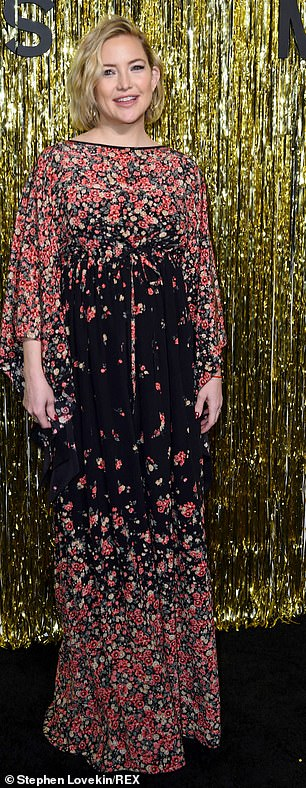 Flower power: The 39-year-old Almost Famous star's black maxi dress featured floral pattern all over the shoulder and neckline down the sleeves as well as by the hemline