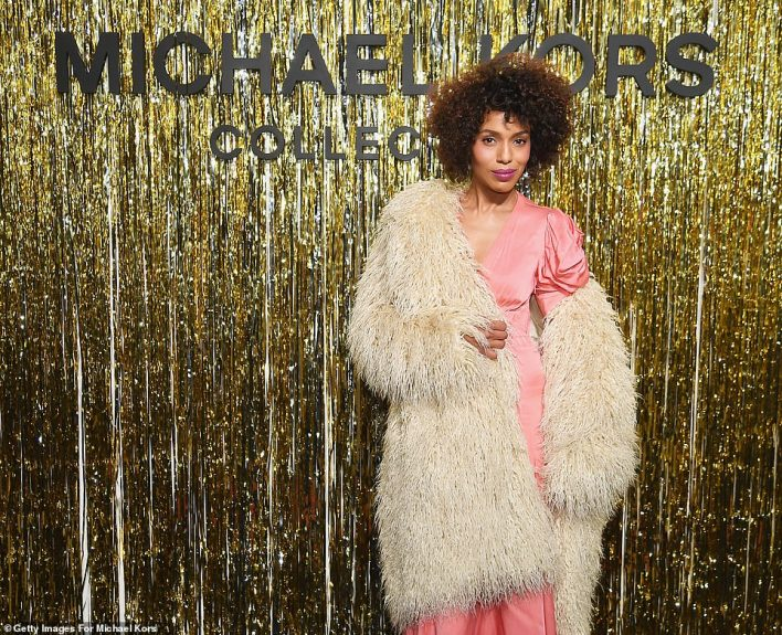 Simply stunning:The former star of Scandal's brown tresses were in an afro as she sported fuchsia lipstick