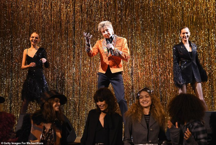 Wow factor:The closing of the show featured all the runway models - including Bella who was right next to him (right) - dancing to the 1978 classic