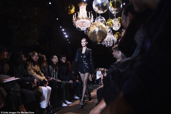 Rocking it:She showed off her model legs in fishnet stockings as well as matching black stilettos featuring feathers around the top