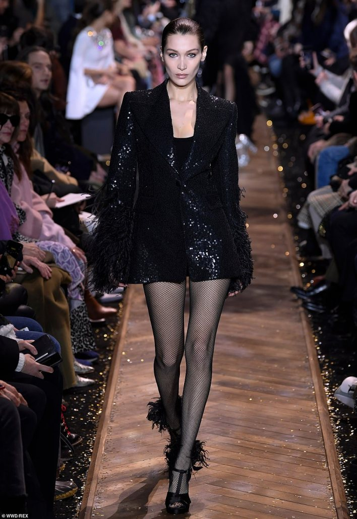Wow factor: The 22-year-oldgirlfriend of The Weeknd sported a sequined blazer featuring a feathered detailing at the end of the sleeves over an LBD