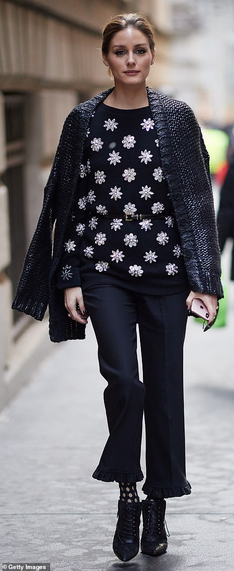 Strut your stuff: She was pictured outside the show wearing a chic monochrome ensemble, including ruffle-hemmed jeans
